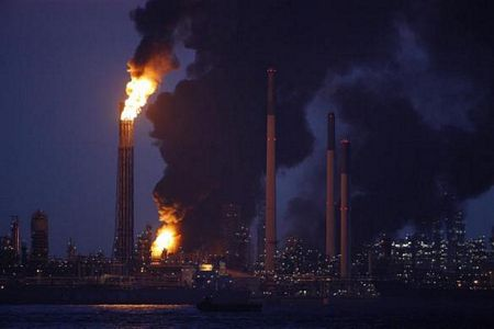 Smoke and flames engulf the Royal Dutch Shell's Pulau Bukom offshore petroleum complex in Singapore