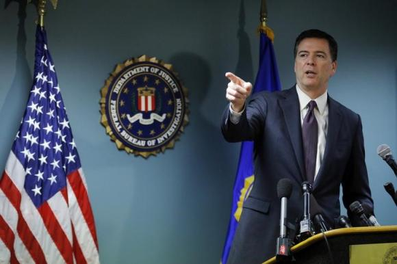 FBI Director James Comey takes a question from reporter during a news conference at the FBI office in Boston